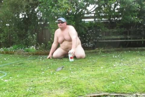 overweight man Playing In The Mud outdoors