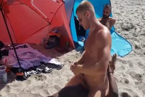 black And White homosexual On A Public Beach. Interracial Outdoor
